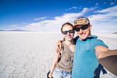 Tourist selfie at Uyuni Salt Flats (Salar de Uyuni), Uyuni, Bolivia, South America