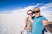 Tourist selfie at Uyuni Salt Flats (Salar de Uyuni), Uyuni, Bolivia, South America
