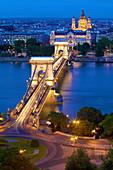 Chain Bridge, Four Seasons Hotel, Gresham Palace and St. Stephen's Basilica at dusk, UNESCO World Heritage Site, Budapest, Hungary, Europe