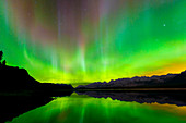 Aurora (Northern Lights) reflected in Lower Kananaskis Lake, Peter Laugheed Provincial Park, Alberta, Canada, North America