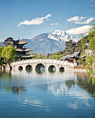 Moon Embracing Pavilion and Suocui Bridge at Black Dragon Pool in Jade Spring Park, Lijiang, Yunnan, China, Asia