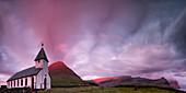 Panoramic of church of Vidareidi at sunrise, Vidoy island, Faroe Islands, Denmark, Europe