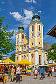 View of Church (Barocke Pfarrkirche) and market in St. Johann, Austrian Alps, Tyrol, Austria, Europe