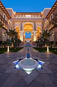 Water feature and architecture at night of luxury hotel, Saadiyat island, Abu Dhabi, United Arab Emirates, Middle East