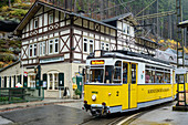 Historic Kirnitzschtalbahn passes half-timbered house, Lichtenhain, Kirnitzschtal, Elbe Sandstone Mountains, Saxon Switzerland National Park, Saxon Switzerland, Saxony, Germany