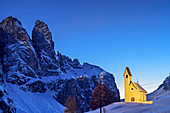 Illuminated chapel in front of rock towers of the Sella group, Dolomites, Dolomites World Heritage Site, South Tyrol, Italy