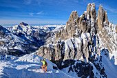 Woman on ski tour climbs into the Forcella del Nevaio, Cadini Group, Dolomites, Dolomites World Heritage Site, Veneto, Veneto, Italy