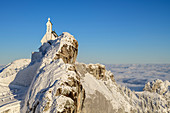 Snow-covered chapel on Wendelstein with sea of fog in the background, Wendelstein, Mangfall Mountains, Bavarian Alps, Upper Bavaria, Bavaria, Germany