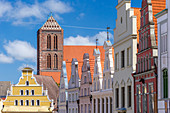 Krämerstraße, roofs, view from south toward north, at the end of the street yellow building of Löwenapotheke, and tower of St. Nikolai church, Wismar stadt, Mecklenburg–Vorpommern, Germany.