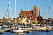 St. Nikolai gothic church viewed from the marina located beside Stockholmer Strasse, Wismar stadt, Mecklenburg–Vorpommern, Germany.