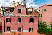 House with red facade, Venice, Italy