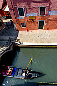 Canal with gondola from above, Venice, Italy