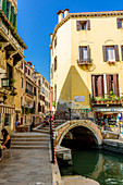 Canal with small bridge in the San Polo district, Venice, Italy