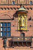Detail of facade of Copenhagen City Hall (Kobenhavns Radhus), builded in 1905. Gold statue of Absalon bishop, Copenhagen, Zealand, Denmark