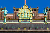 Detail of facade of Copenhagen City Hall (Kobenhavns Radhus), builded in 1905. Gold crest of Copenhagen, Copenhagen, Zealand, Denmark