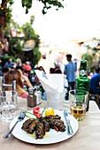 Yaprak Sarmasi - Stuffed vine leaves in a street restaurant, Athens Greece