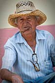 Man with cigar and straw hat in Trinidad, Cuba
