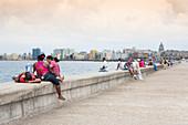 Cubans on the Malecón promenade in Havana, Cuba