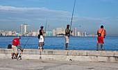 Cuban anglers on the Malecón of Havana, Cuba