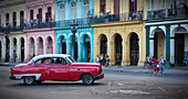 Colorful houses with vintage cars in Havana, Cuba