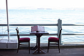 Table with two chairs on the restaurant level of the Galata Bridge in Istanbul, Turkey.