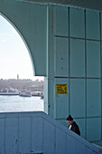 People walking on stairs of the Galata Bridge in Istanbul, Turkey.
