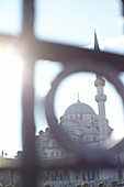 Looking through a fence at the blue blue mosque in Istanbul, Turkey