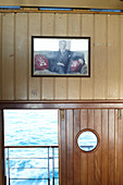 Ataturk portrait in the interior of a Bosphorus ferry from the European part to the Asian part of the city of Istanbul, Turkey.