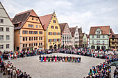Shepherd dance in period clothing in the historic city center, Rothenburg ob der Tauber, Franconia, Romantic Road, Bavaria, Germany