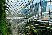 Waterfall in the Hall of Gardens by the Bay, overlooking the Marina Bay Sandy hotel, Singapore