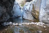 Small waterfall in the gorge along the Rio de Taburiente, Caldera de Taburiente, La Palma, Canary Islands, Spain, Europe