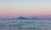 Stromboli volcano and Panarea island with sea in sunset, Sicily Italy