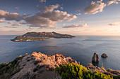 Lipari coastline with view of Vulcano volcanic island in sunset, Sicily Italy