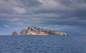 Basiluzzo island in front of Stromboli with clouds, Sicily Italy