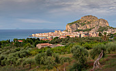 City of Cefalu with Rocca di Cefalù in the afternoon sun, Sicily Italy
