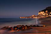 Cefalu city skyline with beach at night Sicily Italy