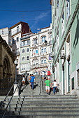 Stairs with tourists at Praca do Comercio in Coimbra, Portugal