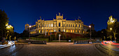 Illuminated Maximilianeum in Munich at night with traffic, Bavaria