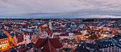 Over the rooftops of Munich at sunset, view from above of Viktualienmarkt and Heiliggeistkirche