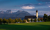 Pilgrimage church Wilparting am Irschenberg in summer, with mountains in the background, Bavaria