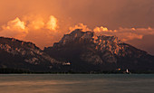 Neuschwanstein Castle and Hohenschwangau on Forggensee in the Ammer Mountains with clouds at sunset, Bavaria
