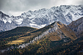 View from the Kreuzeck into the Reintal and snow-covered mountains near Garmisch-Partenkirchen in autumn, Bavaria