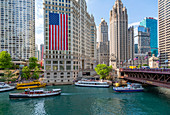 View of American flag on the Wrigley Building and Chicago River, Chicago, Illinois, United States of America, North America