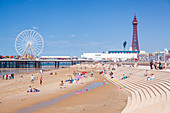 Blackpool Tower, Blackpool Beach, Blackpool Central Pier with holidaymakers and tourists, Blackpool, Lancashire, England, United Kingdom, Europe