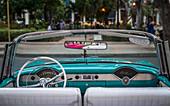 Vintage American taxi car interior, Havana at dusk, La Habana, Cuba, West Indies, Caribbean, Central America