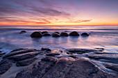 The Moeraki Boulders with incredible sunrise, Moeraki Beach, Otago, South Island, New Zealand, Pacific