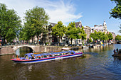 Tourist boat on a canal, Amsterdam, North Holland, The Netherlands, Europe
