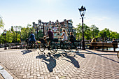 Cyclists on a bridge over Brouwersgracht, Amsterdam, North Holland, The Netherlands, Europe