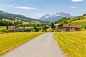 View of trainline and Ellmauer Halt Mountain peak near St. Johann, Austrian Alps, Tyrol, Austria, Europe