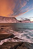 A dramatic sunset at Haukland Beach, Lofoten, Nordland, Arctic, Norway, Europe